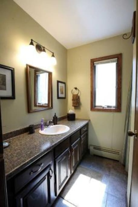 Beautiful Granite vanity and tile in main floor guest bath