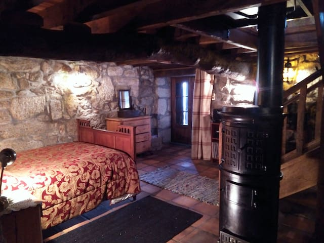 The main bedroom with a wood burning stove