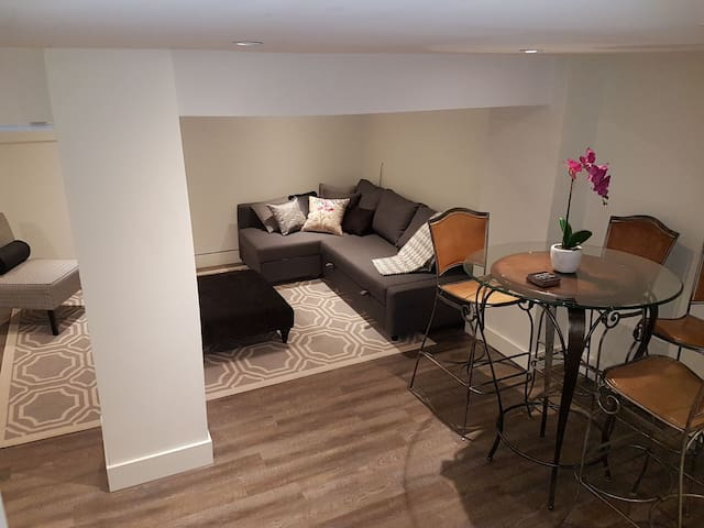 Living Room with Sectional that pulls out to double bed.  Bistro table that seats 4.  All new furniture.