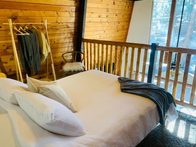 Loft bedroom with one queen bed