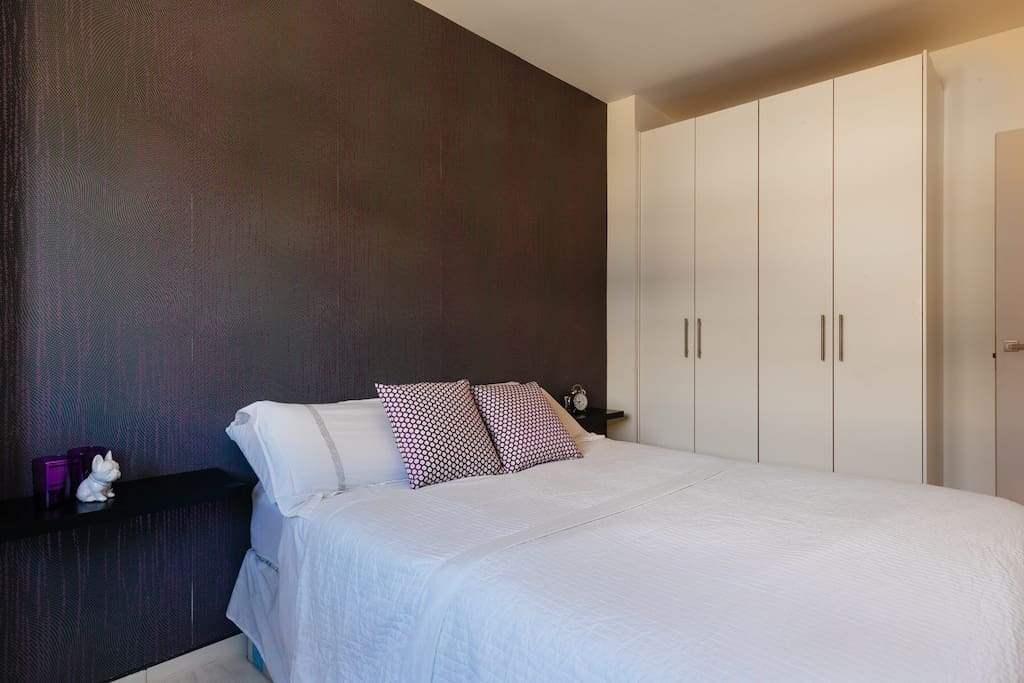 Double bed, blackout blinds and large wardrobe.