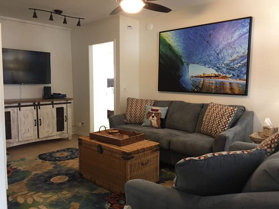 "Living room with 55"" flat screen TV and full cable"