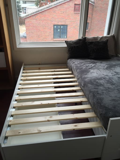Bed pulls out to a double. Second mattress goes on top.