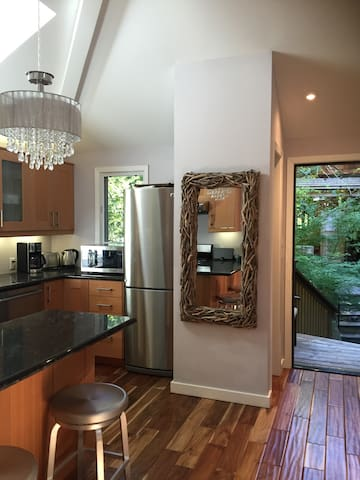 Large refrigerator, oven, stove and microwave.