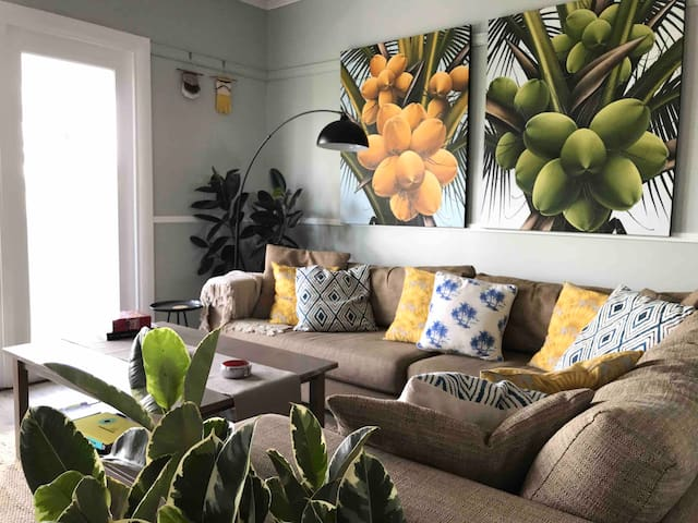Beautiful tropical lounge room with large comfortable corner lounge, leads onto front verandah through French doors