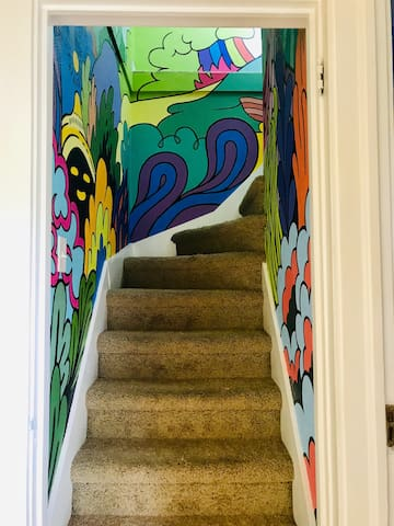 Just follow the art upstairs.