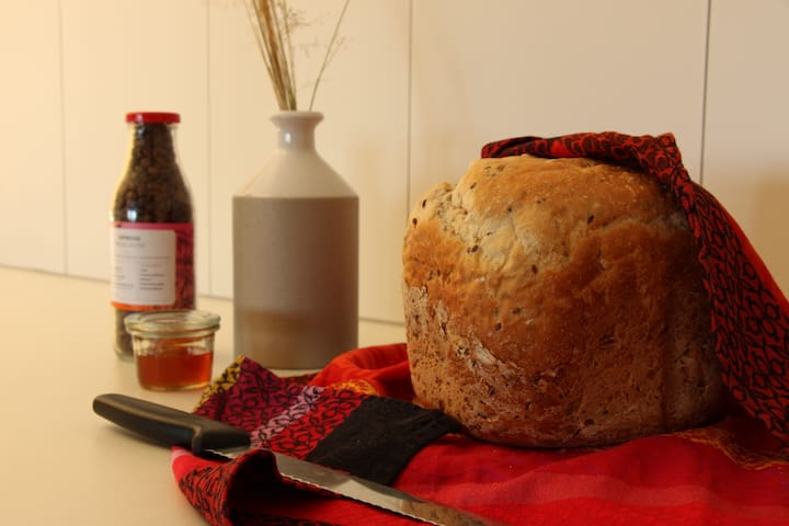 Fresh bread with local raw honey and homemade jams provided