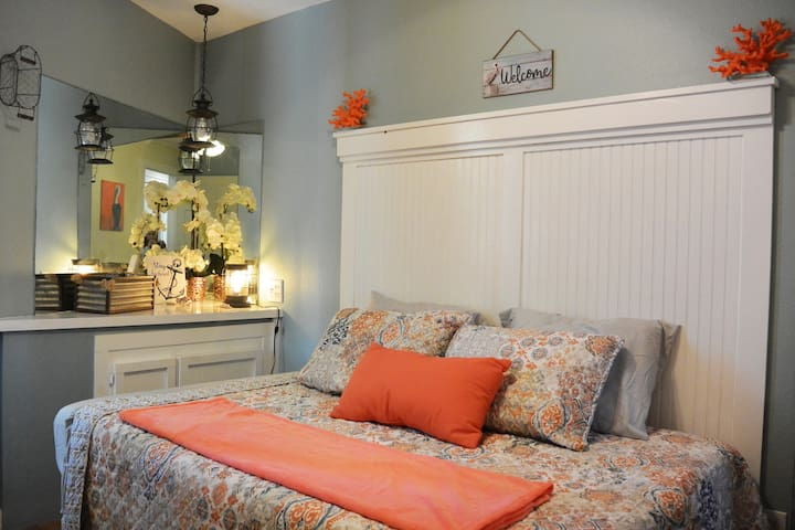 Master bedroom, coral inspired decor