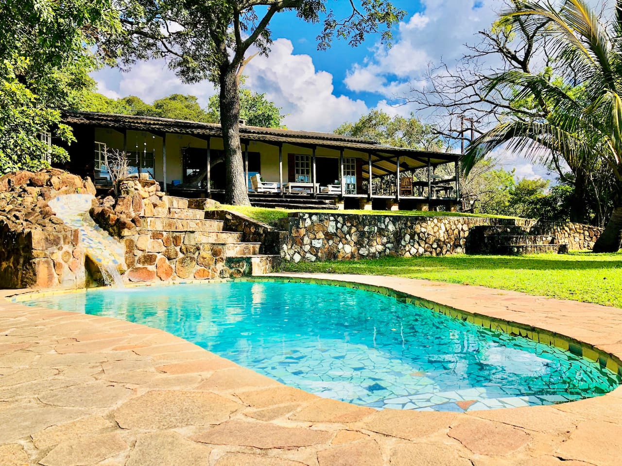 Relax by the pool or on the breezy veranda