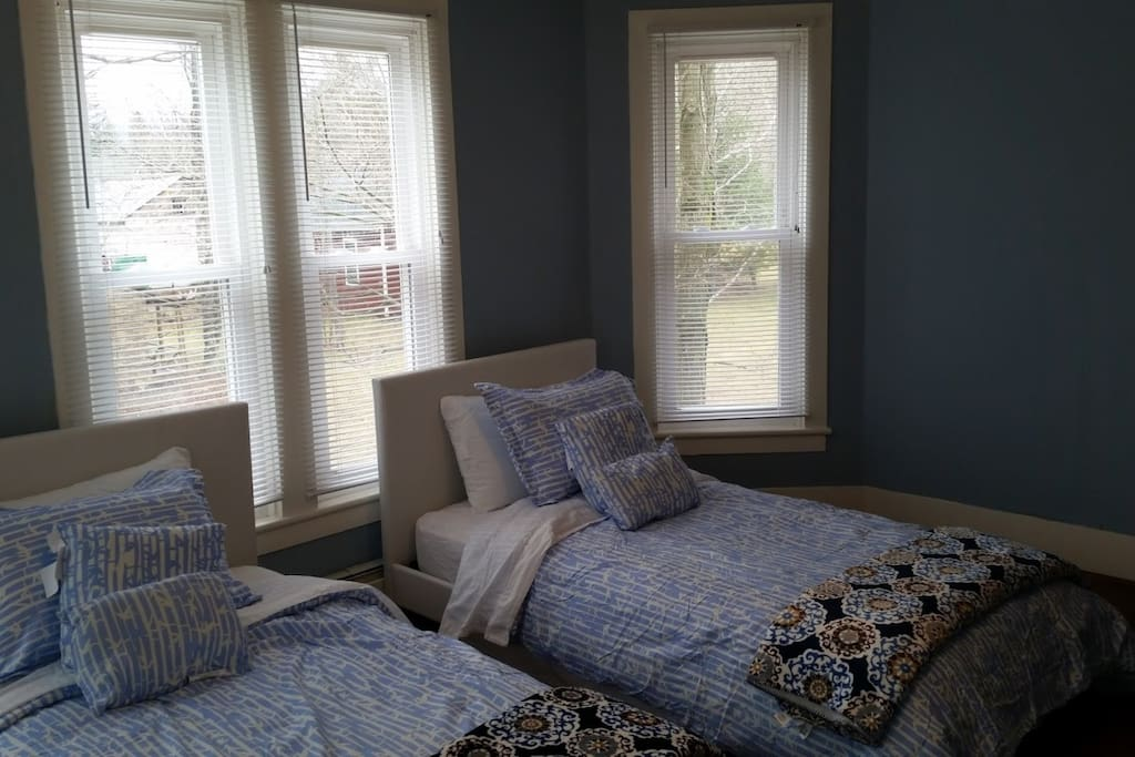 Bedroom 1, 2 full beds, convertible to 1 king upon request