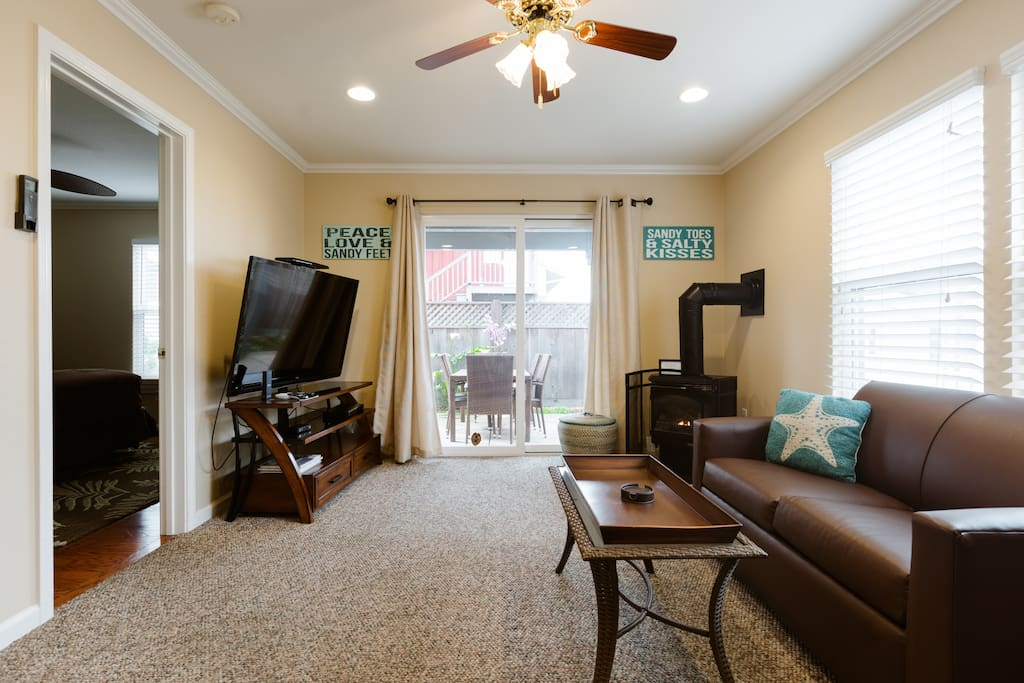 As soon as you enter you'll see the Downstairs Suite with gas fireplace and private patio on the right.