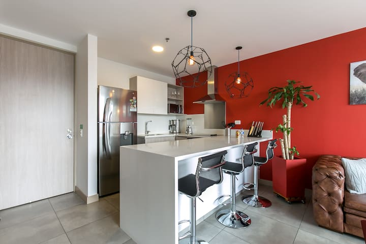 Great room, which combines kitchen, dining room, and living room in one shared space.