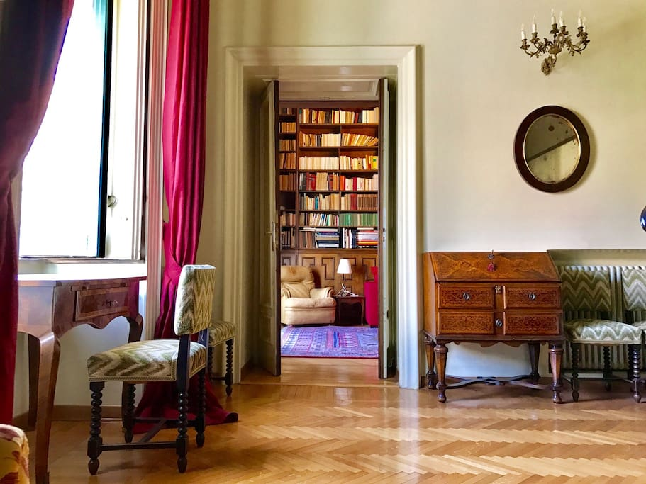 Precious antiquities in the main double bedroom with 2 levels one of which with a writing area, wardrobe and armchairs