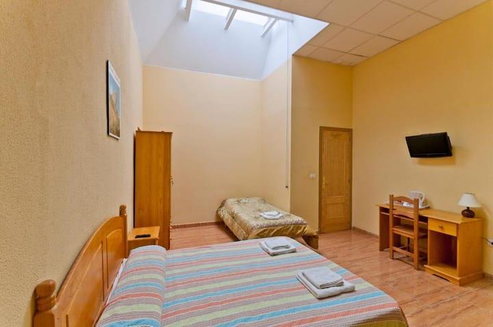 Habitación Triple en Hostal Kasa