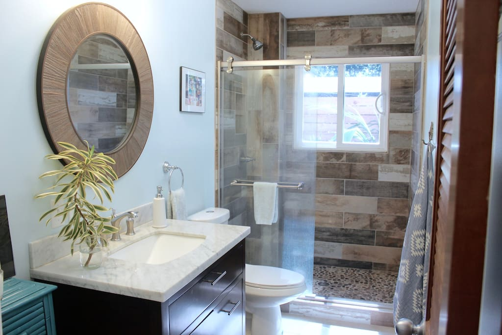 Large Private Bathroom with pebble bottom shower