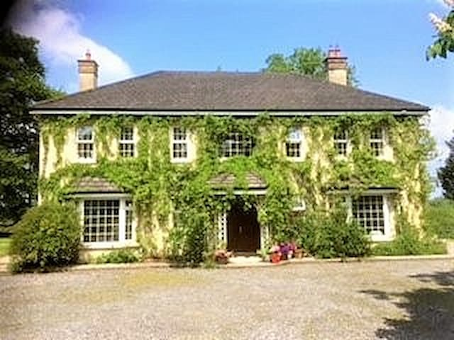 Inishconnell House with forest, fishing, fields.