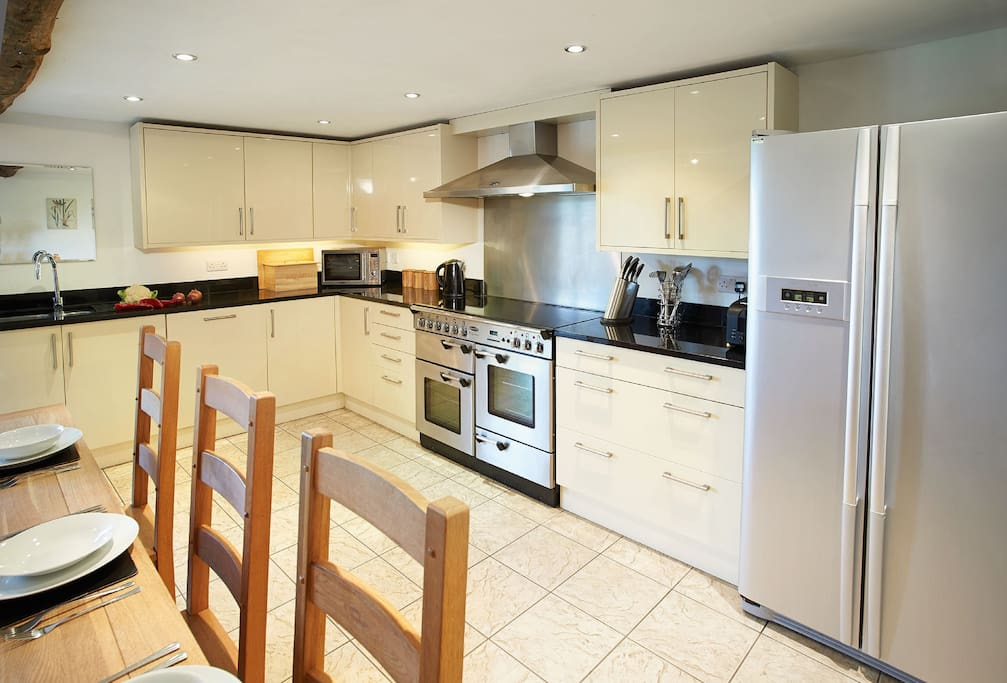 Ground floor: Large kitchen/dining/family room, with French doors to terrace and garden. Dining table can be extended to seat 12