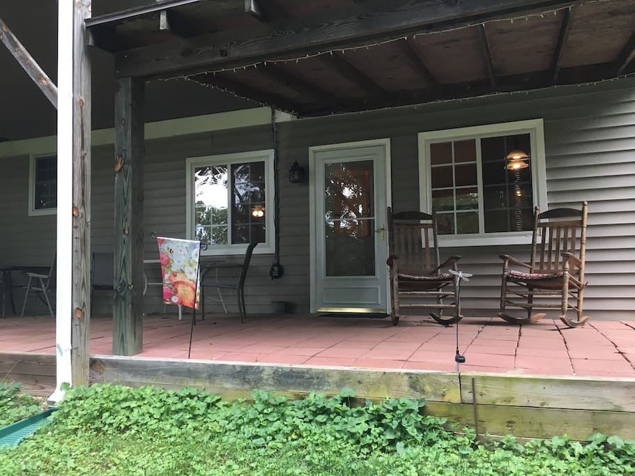 Patio and private entrance to apartment with rocking chairs to relax.