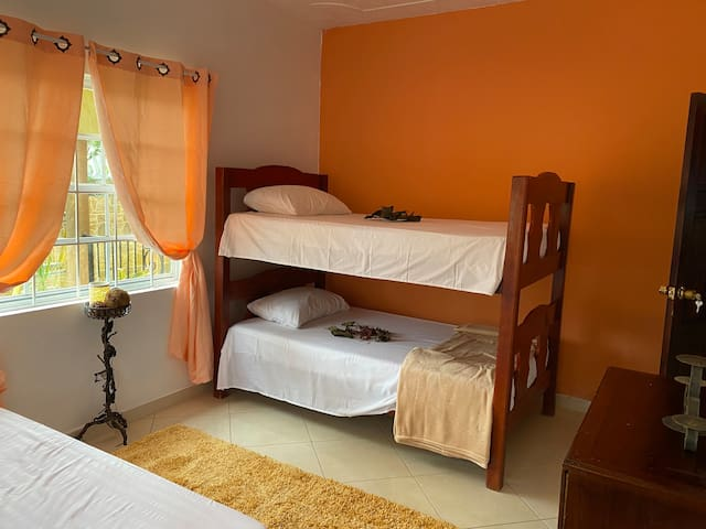Guest room sleeps 4! Double bed and a bunk bed. Light and airy with an eclectic feel!