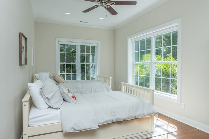 """The """"Second Bedroom"""" is this Sleeping Area of Two Twin Beds Plus a Trundle Bed.  Beautiful Views of the Forest and Garden!"""