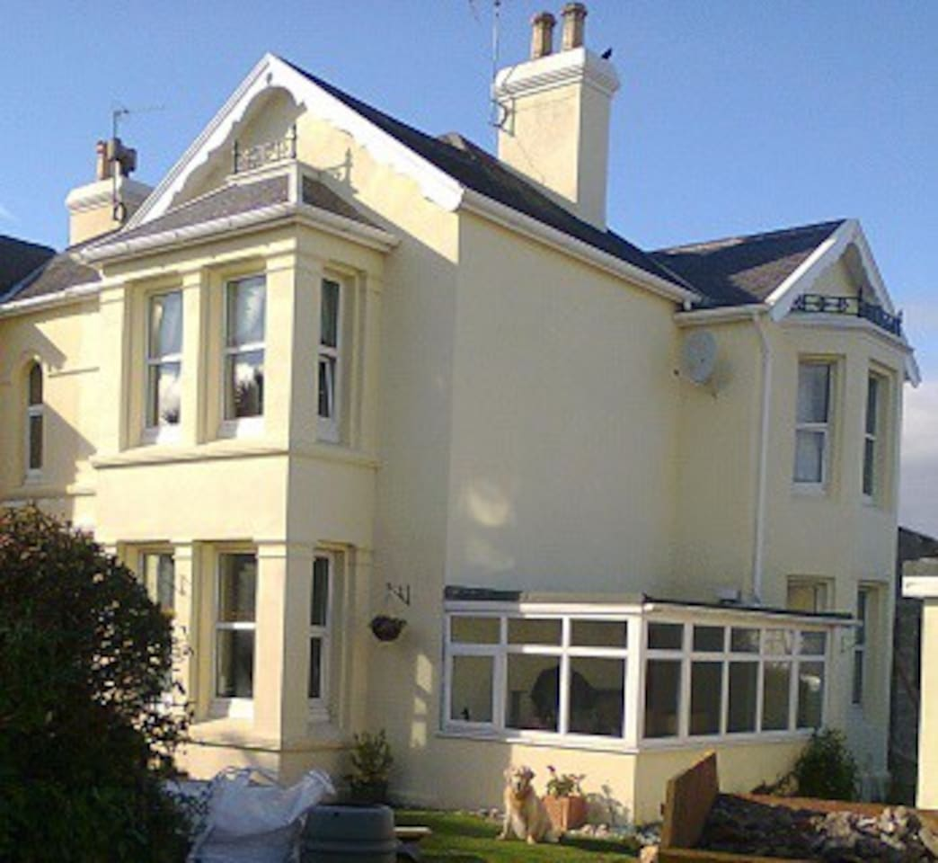 Large sunny Victorian  house, with off road parking and private gardens on 3 sides with outside patio area.