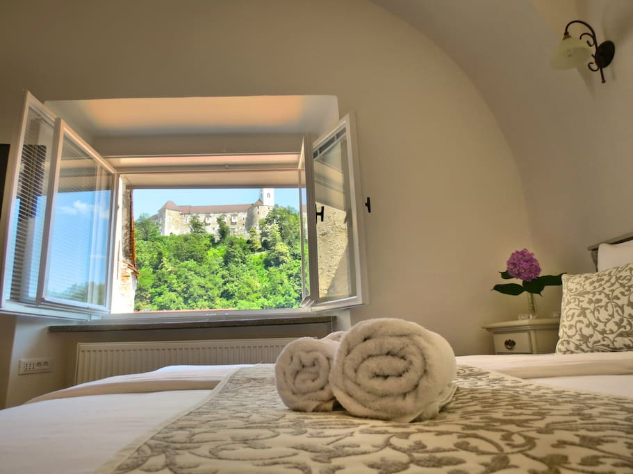 Beautiful bedroom with a view on castle