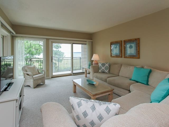 Living Room with Balcony Access and Views of Calibogue Sound at 1834 Beachside Tennis