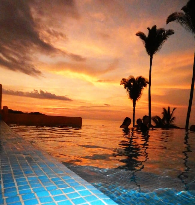Spectacular sunsets viewed from within our infinity pool