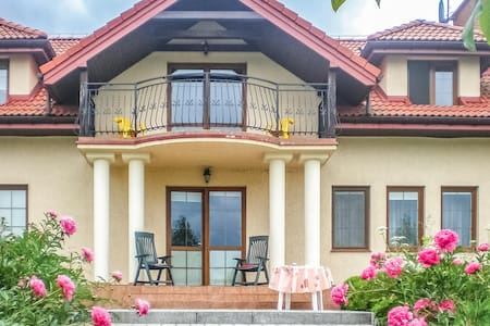 Holiday cottage with 6 bedrooms on 355m² in Bajtkowo
