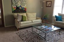 Very comfortable and stylish lounge room. Flat screen TV.
