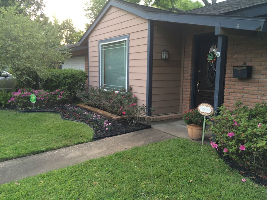 Flowerbeds and picture window