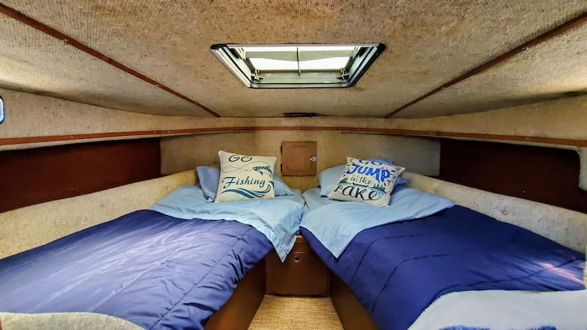 Forward bow sleeping berth, sleeps 2 comfortably, and has closing door for privacy, and 2 windows and skylight hatch for natural light and ventilation