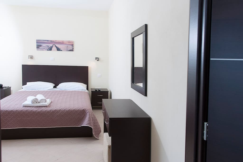 Bedroom with a tv,cable and satelite.Air condition is also provided