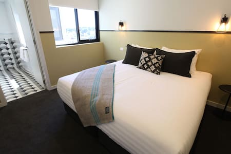 Master bedroom in luxury balcony apartment