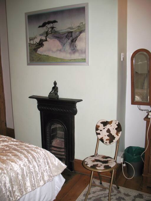 Victorian fireplace with vintage art