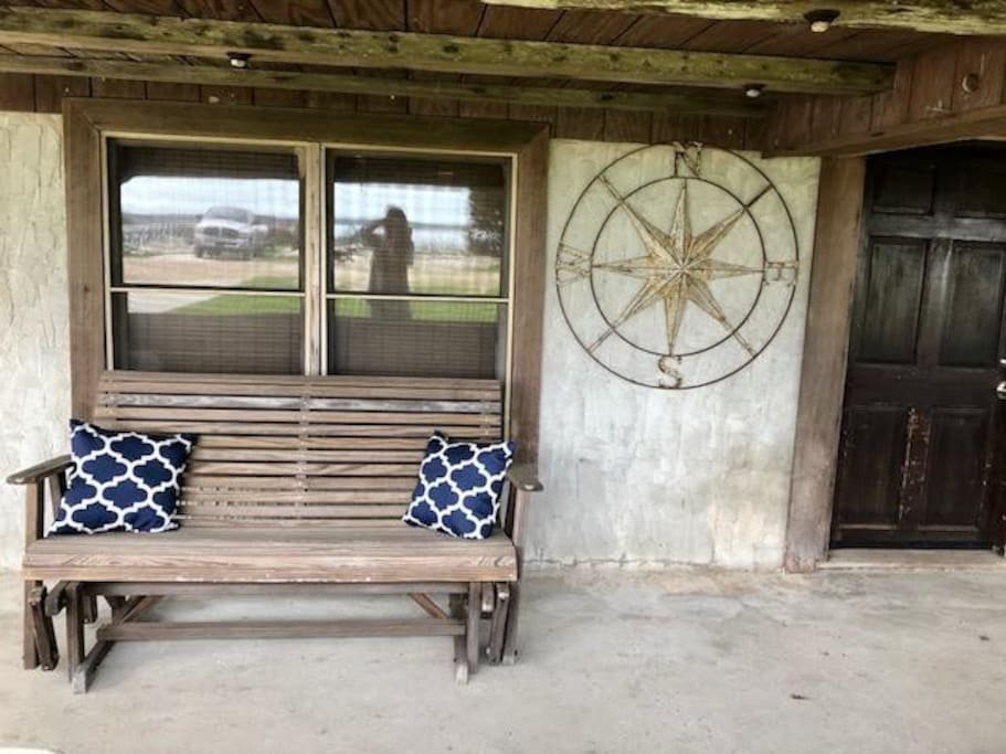 The front porch - a table and chairs are also set up on the right side of the door - a perfect spot to sit coffee and watch the sunrise over the water!