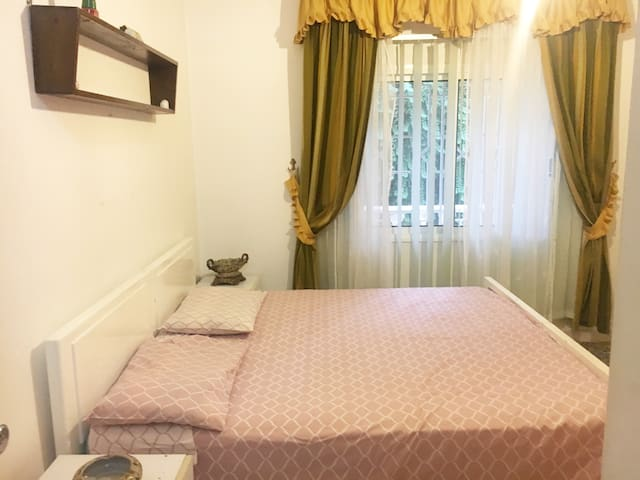 Bedroom # 2  Two large single beds (120x200 cm-convertible to king size bed ) & two adult bunk beds , wall cupboard (4) , 2 side tables , renovated curtains + vertical blinds , en-suite full bathroom with bath tub . Overhead storage area & loft.