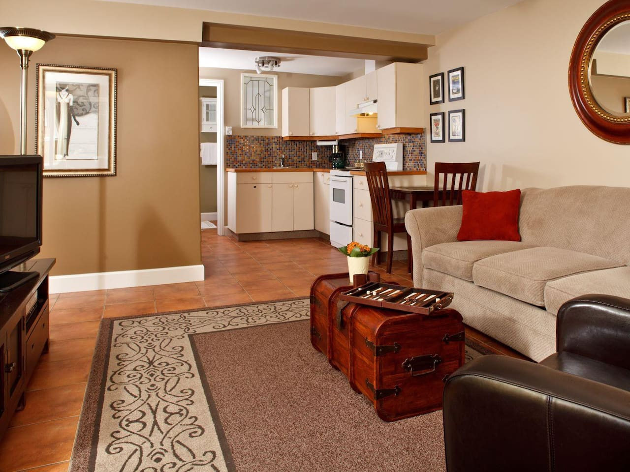 Enjoy a comfortable living room with flat screen TV and full kitchen facilities