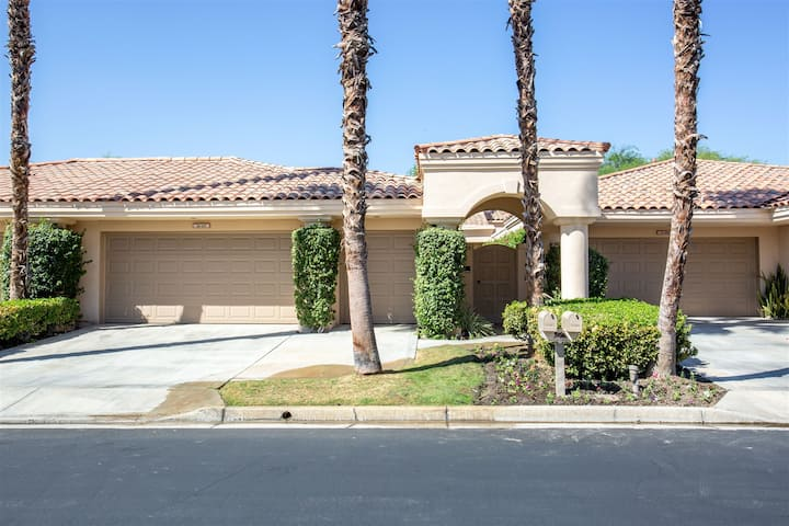 Beautiful Mountain and Golf Course Views from this Charming Open 3 Bedroom Condo at PGA West