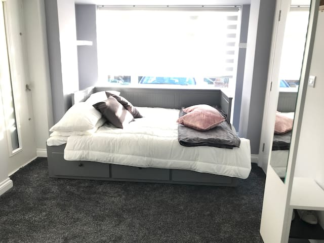 Very Comfortable daybed, which can be used as a sofa during the day and which can easily pull-out to make a kingsize bed at night. very comfortable for 2 adults.