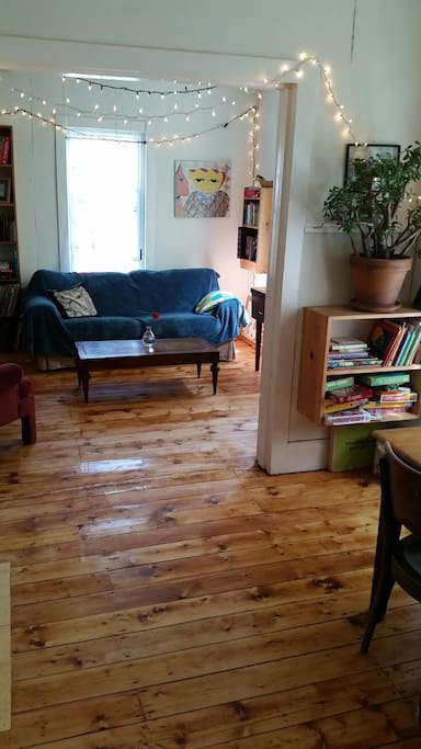 Newly refinished original wood floors add to our home's cozy and authentic feel