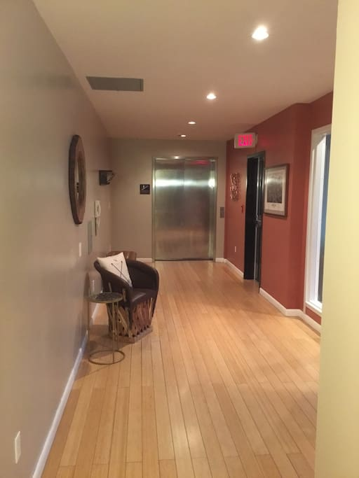 The Front Entry hallway connects to the elevator and has a separate door to stair access