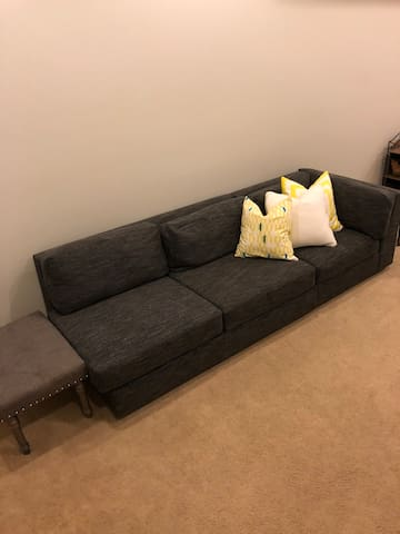 """Basement couch 88"""" - plenty long enough to sleep on!"""
