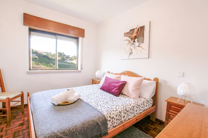 1st Bedroom  - Double Bed, overlooking pool area and gardens