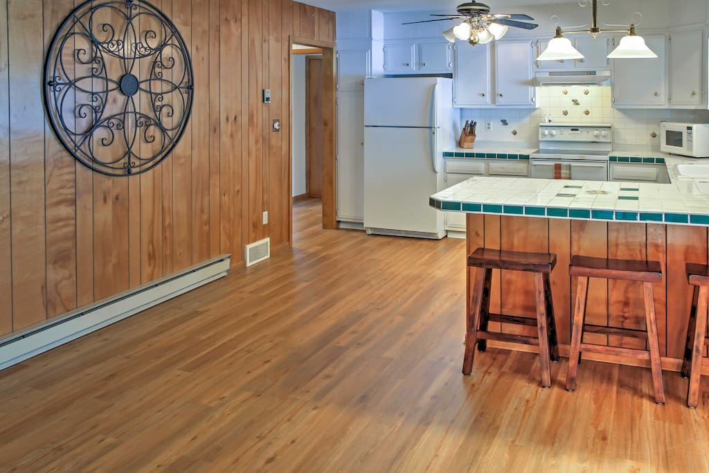 This home fully embodies the warmth of a cabin thanks to the authentic wood that lines the floors and walls.