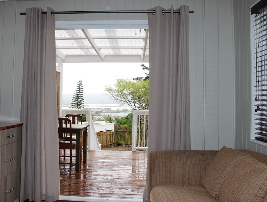 View from couch and bed towards garden, old town and lagoon. Table for two on deck to enjoy meals served on deck when weather permits or in the comfort of your room