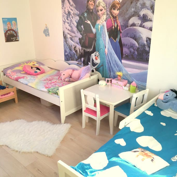 Kids room with 2 children beds.