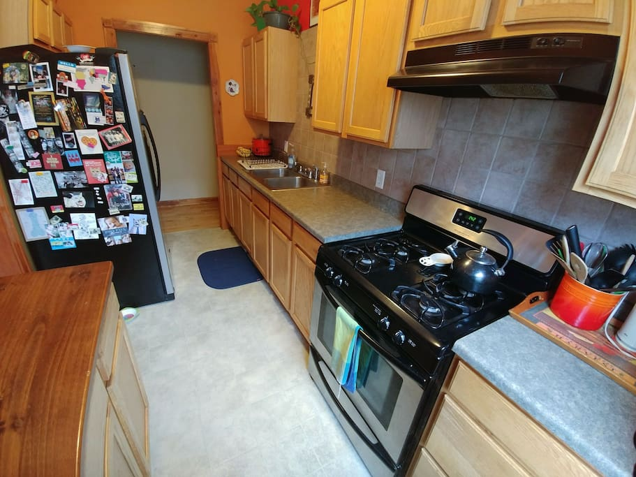 Fully equipped kitchen with large refrigerator