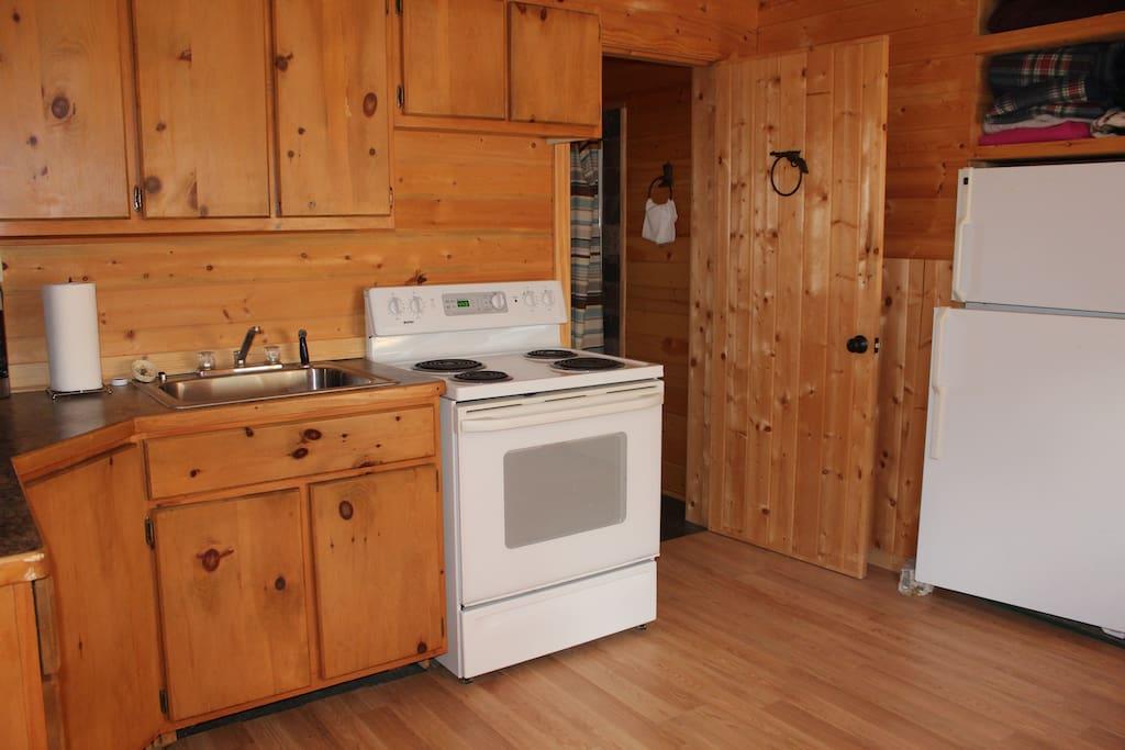 Plenty of cabinets,  fridge, stove, microwave and coffee pot. plates silverware ect.