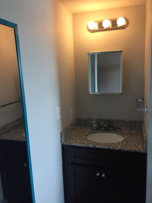 Sink and medicine cabinet with mirror outside the bathroom space for your convenience
